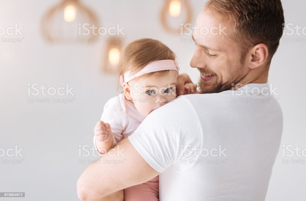 Happy bearded father hugging his daughter at home foto de stock royalty-free