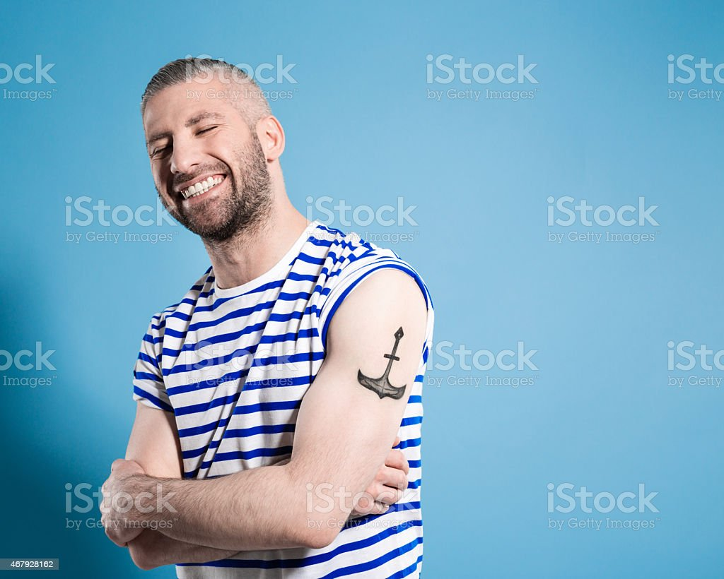 Happy bearded sailor man wearing striped t-shirt - Royalty-free 2015 Stock Photo