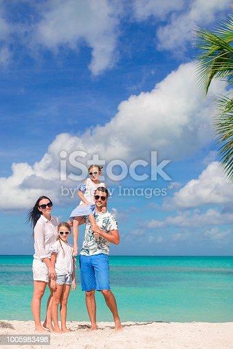 istock Happy beautiful family on the beach 1005983498