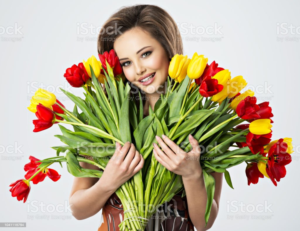 Happy beautiful girl with flowers in hands stock photo more happy beautiful girl with flowers in hands royalty free stock photo izmirmasajfo