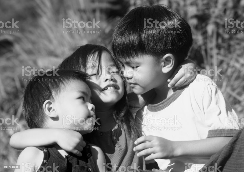 Happy beautiful kids with brothers and sister stock photo