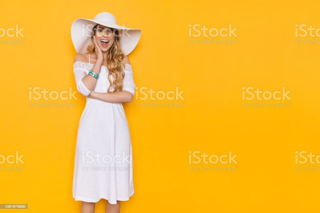 edd0147541c4 Happy Beautiful Smiling Young Woman In White Dress And Sun Hat Is Shouting  - Stock image .