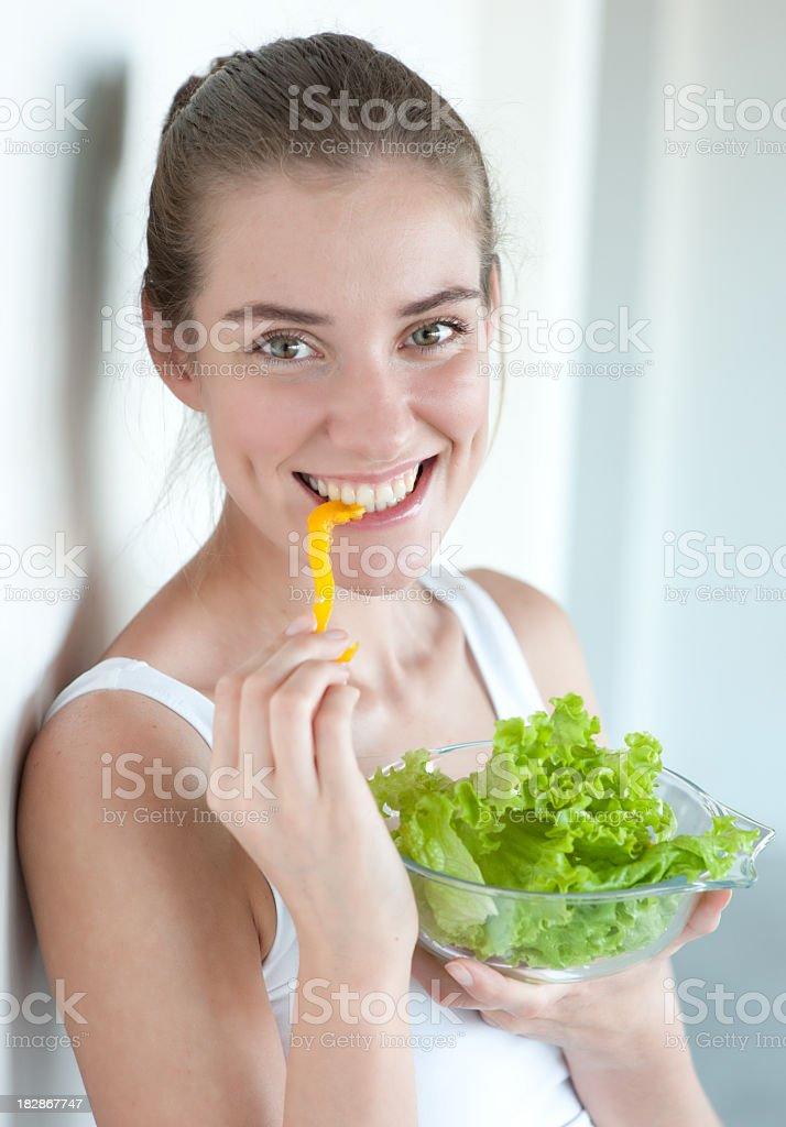 happy beautiful woman eating vegetable salad royalty-free stock photo