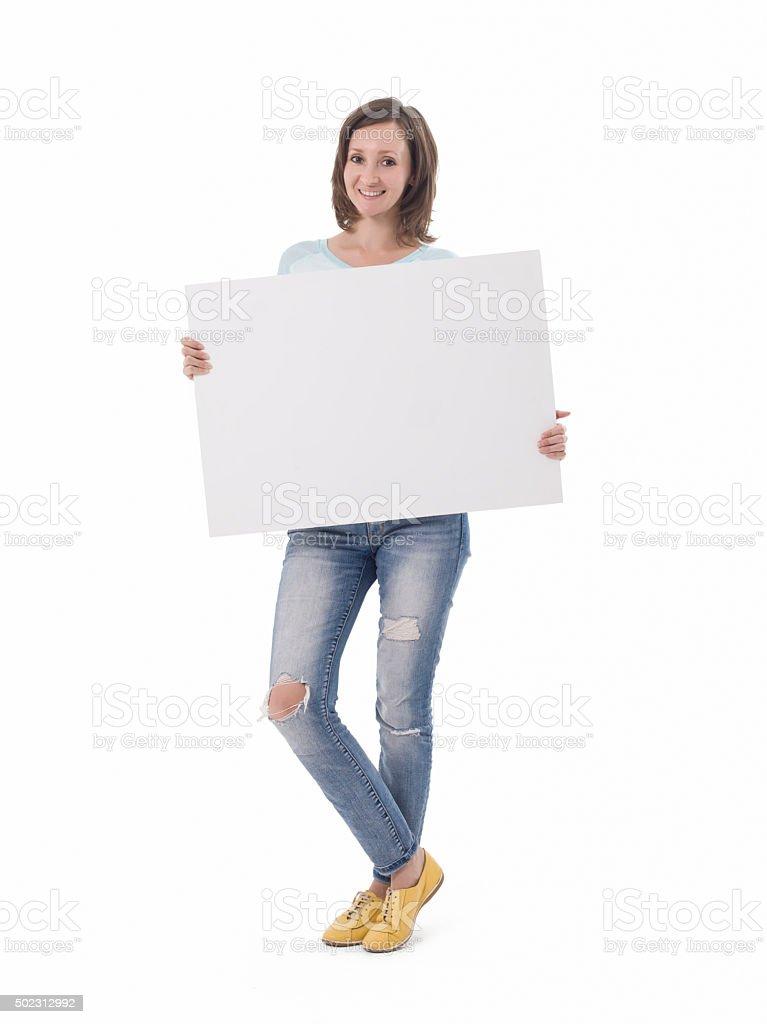 Happy beautiful woman holding blank white placard. stock photo