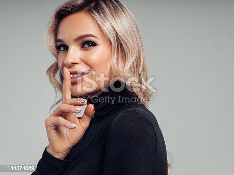 Happy beautiful woman in black sweater