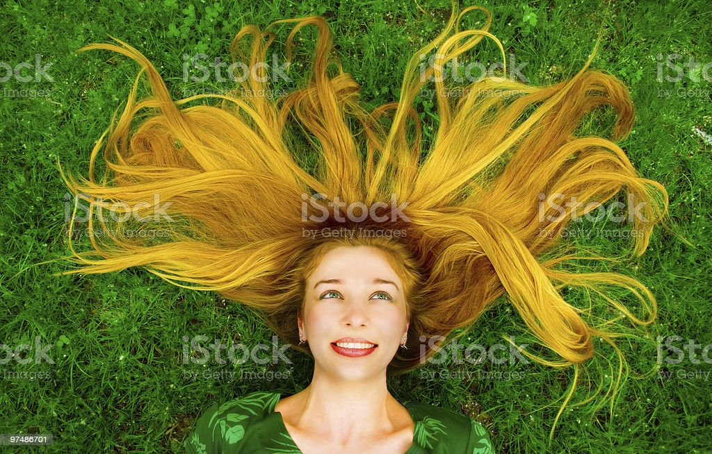 Happy beautiful woman in grass royalty-free stock photo