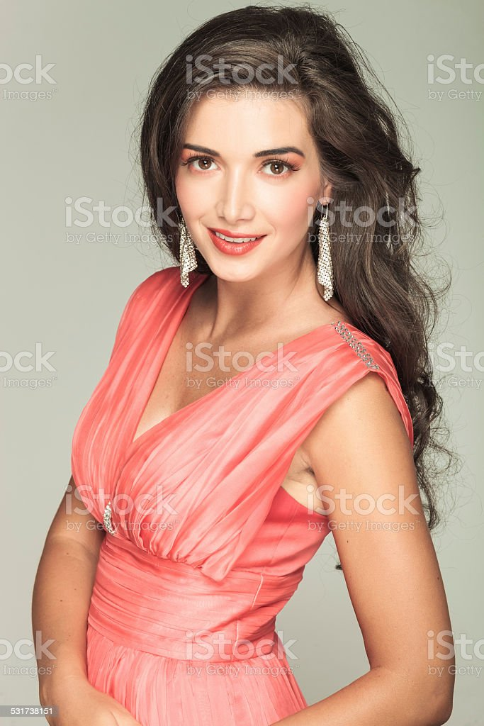happy  beautiful woman in red dress smiling stock photo