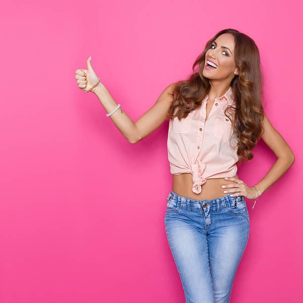 Happy Beautiful Woman Showing Thumb Up stock photo