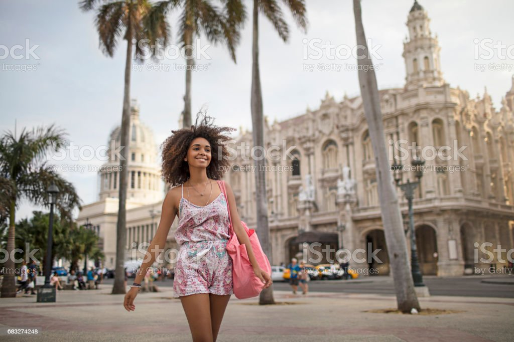 Happy beautiful woman walking in city stock photo