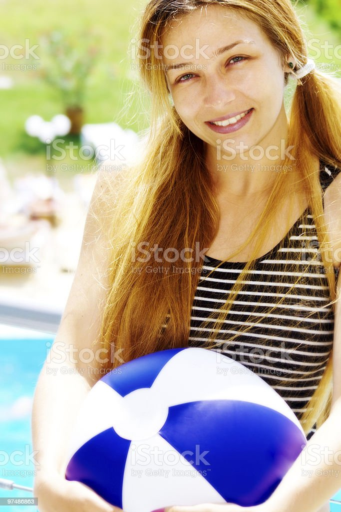 Happy beautiful woman with ball on holiday royalty-free stock photo