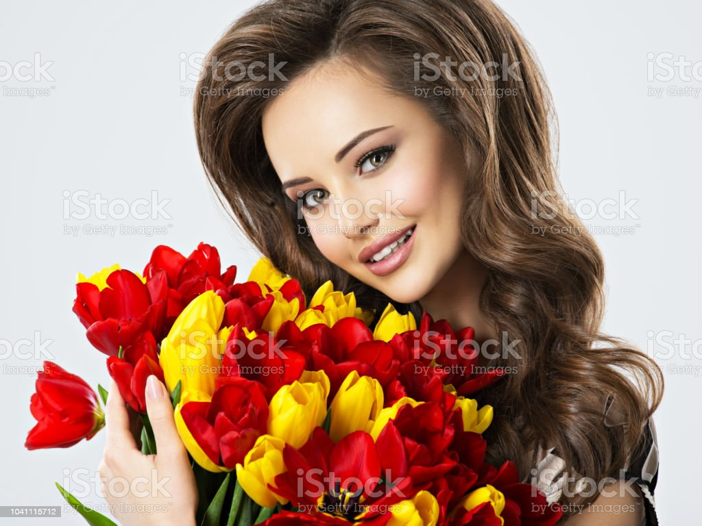 Happy beautiful woman with flowers in hands stock photo more happy beautiful woman with flowers in hands royalty free stock photo izmirmasajfo