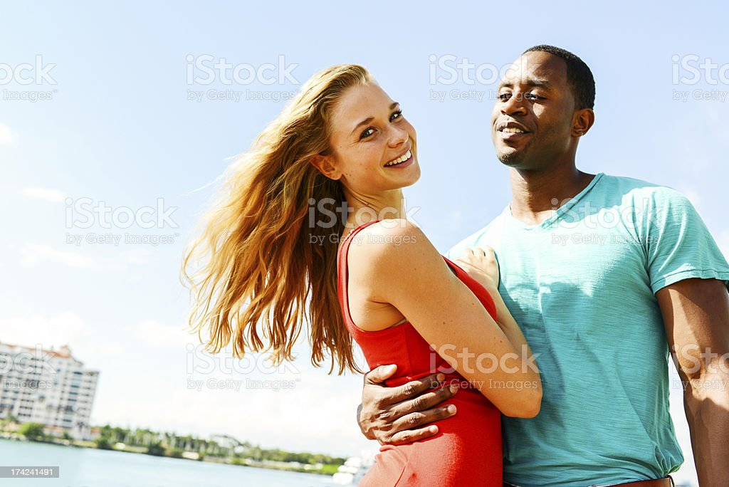 Happy Beautiful Young Couple Having Fun Outdoors royalty-free stock photo