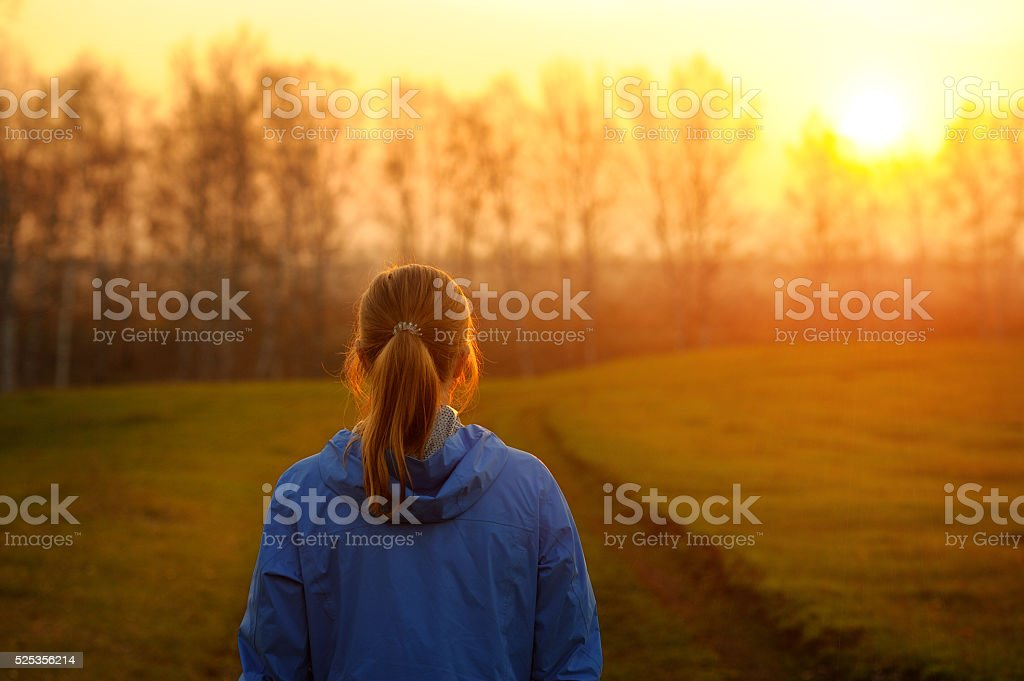 Happy beauty woman dreaming in the Park for the summer. stock photo