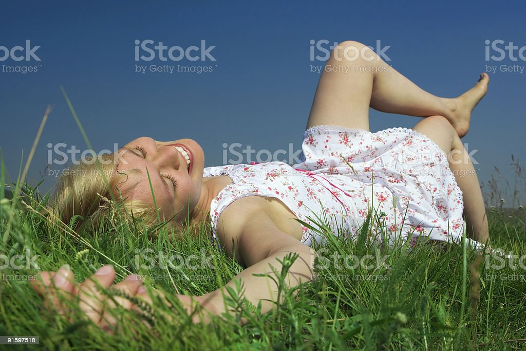happy beauty woman lie on grass royalty-free stock photo