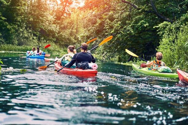 Happy best friends having fun on a kayaks. Kayaking on the river. stock photo