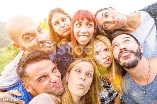 istock Happy best friends taking fun selfie outdoor with back lighting 636247634
