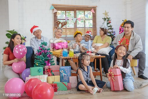 Happy big Asian family enjoy celebrate Christmas together in living room at home, Multi-genneration family concept