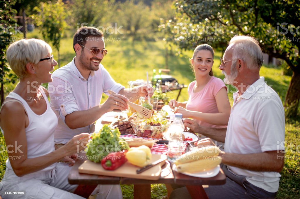 Happy Big Family Having Lunch At Summer Garden Party Stock Photo Download Image Now Istock