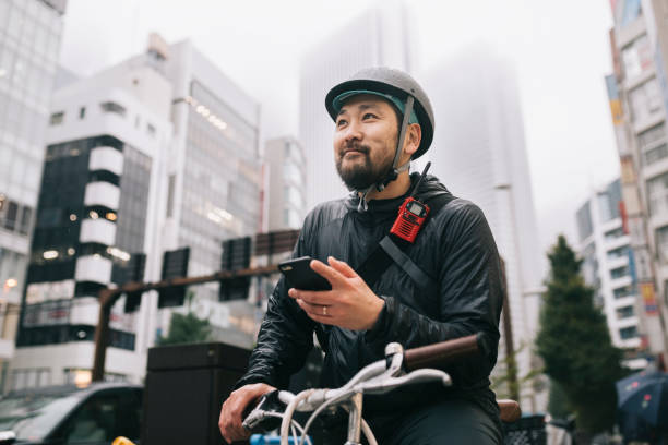 happy bike messenger - side hustle stock pictures, royalty-free photos & images