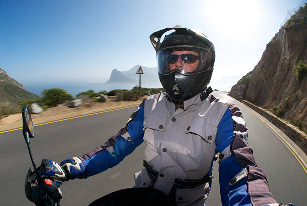 happy biker on the road - helmet visor stock photos and pictures