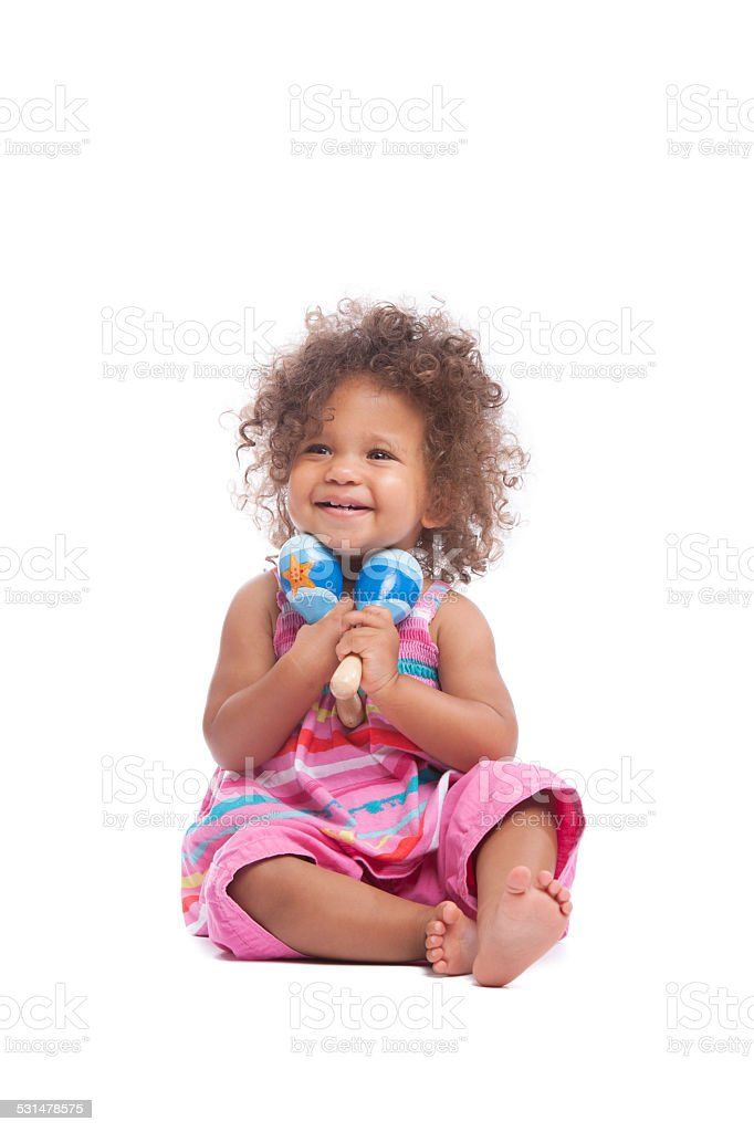 Happy Biracial Baby Girl/ Toddler Holding Maracas Isoltated On White stock photo