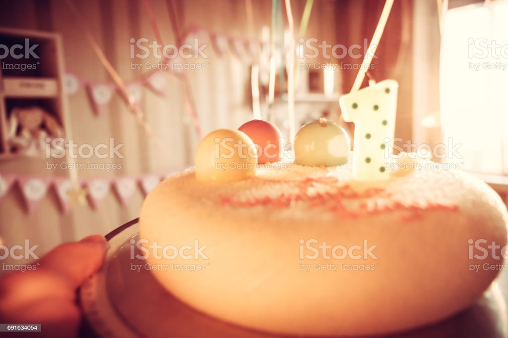 happy birthday cake for children party decorated with one candle and...