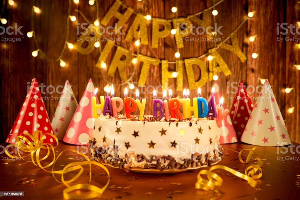Happy Birthday Cake With Candles On The Background Of Garlands A Stock Photo Download Image Now Istock