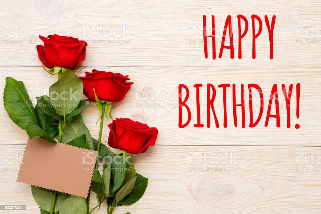 Happy Birthday Card With Red Roses And Craft Paper Card Stock Photo