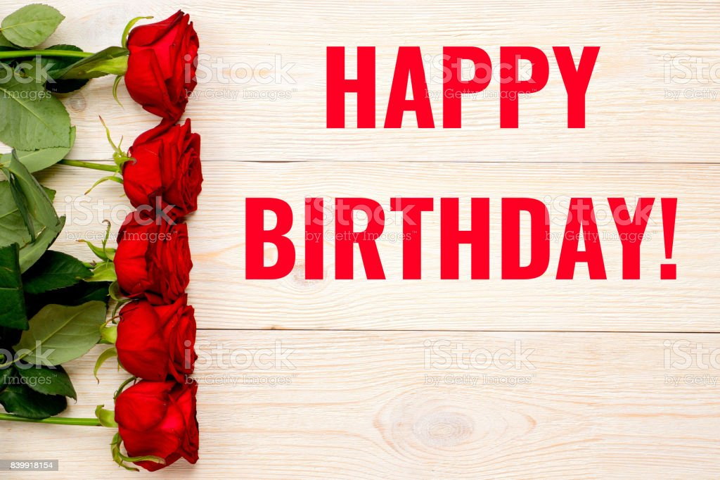 Happy Birthday Card With Red Roses Over Wooden Planks Stock Photo