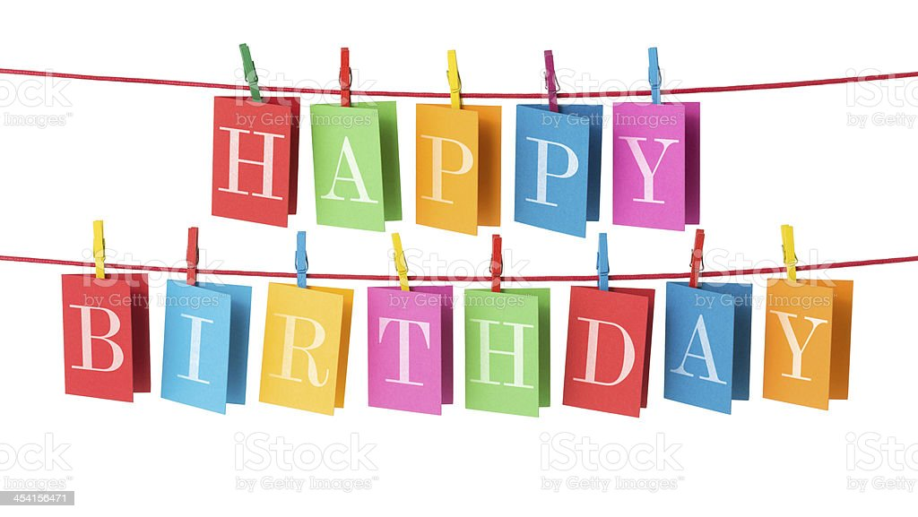 Happy Birthday cards pegged to red cord stock photo