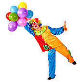 Happy birthday clown holding a bunch of balloons
