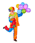 Happy birthday clown man holding a bunch of balloons on Isolated.