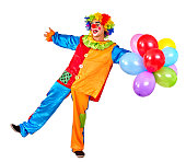 Happy cheerful birthday clown keeps  bunch of balloons and is dancing.  Isolated.