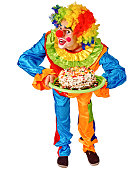 Happy birthday clown holding a cake .  Isolated.