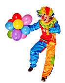 Happy birthday clown holding bunch of balloons.  Isolated.