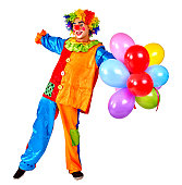 Happy birthday clown holding keeps bunch of balloons.  Isolated.