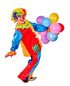 Happy birthday clown playing  bunch of balloons.  Isolated.