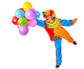 Happy birthday. Glad clown holding a bunch of balloons.  Isolated.