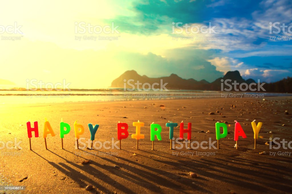 Happy Birthday Colorful Candles On A Beach Sunrise Royalty Free Stock Photo