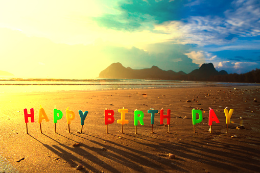 Happy Birthday Colorful Candles On A Beach Sunrise Stock