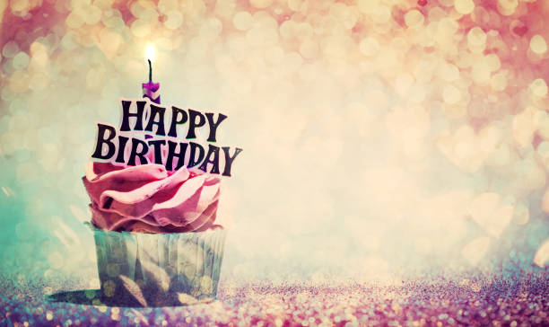 Happy birthday cupcake on glitter colorful background stock photo