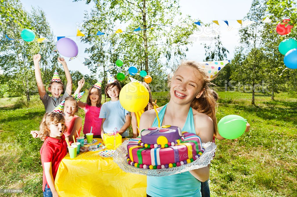 Happy birthday girl holding mastic icing cake stock photo