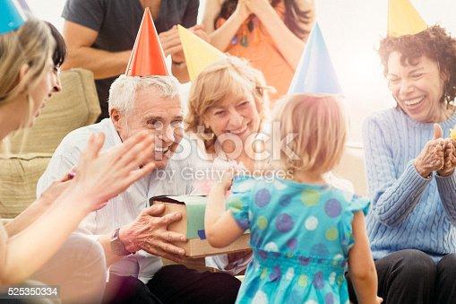 Multigenerational family celebrating great grandfather's birthday