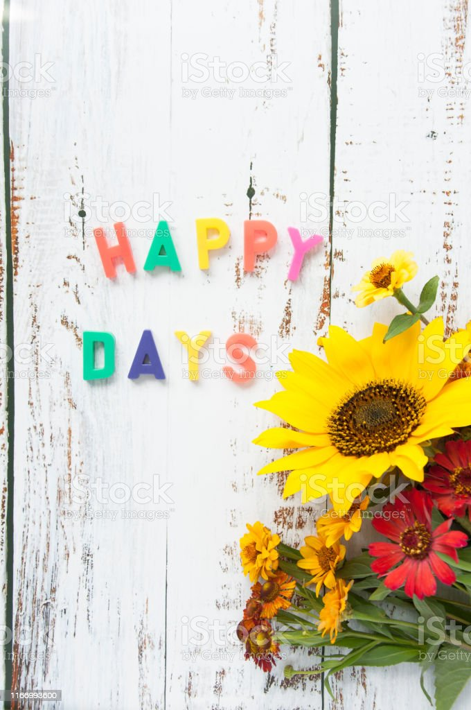Happy Birthday Greeting Card With Flowers Bouquet With Sunflower With A Gift On A Light Wooden Background With Bright Letters Text Congratulation Happy Bday Stock Photo Download Image Now Istock
