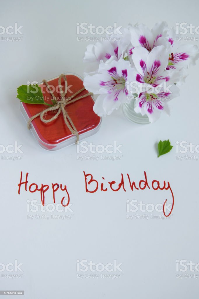 Happy Birthday Greeting Card With Gift Box And Fresh Flowers On White Background Space For