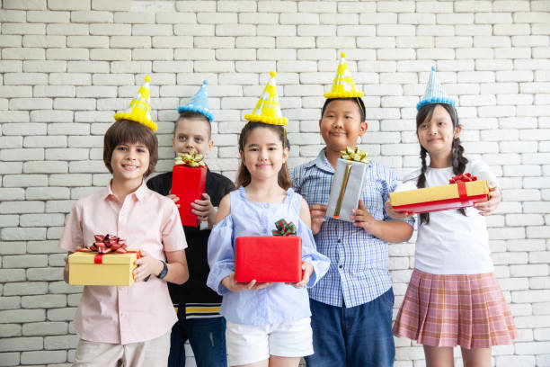 Happy Birthday. Group young people celebrates the holiday with a gifts. Congratulations to a friend Happy Birthday. Group young people celebrates the holiday with a gifts. Congratulations to a friend group of friends giving gifts to the birthday girl stock pictures, royalty-free photos & images