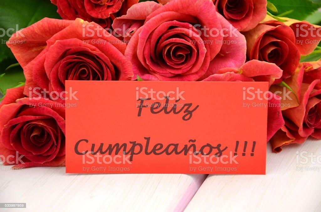 Buon Compleanno In Spagnolo E Mazzo Di Splendide Rose Rosse