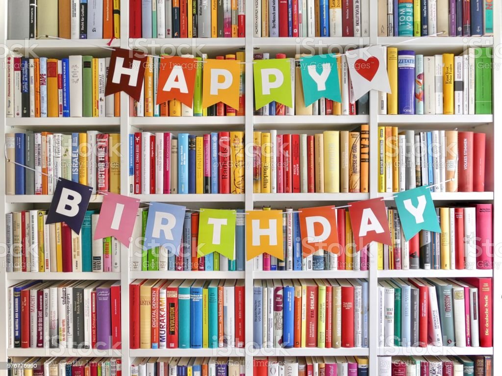 Happy Birthday Letters Hanging On Bookshelf In Library Royalty Free Stock Photo