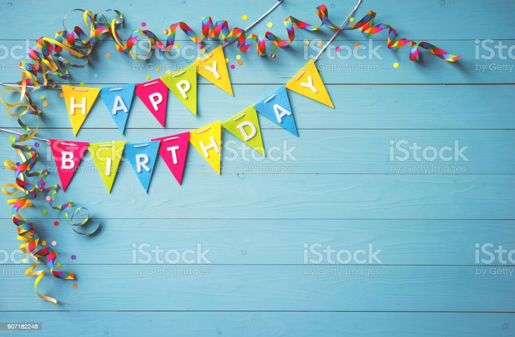 Happy birthday party background with text and colorful tools stock photo