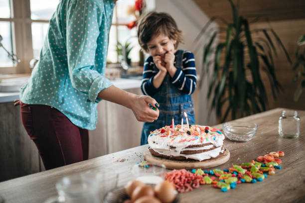 Happy birthday! Young boy enjoying his birthday cake decorating a cake stock pictures, royalty-free photos & images